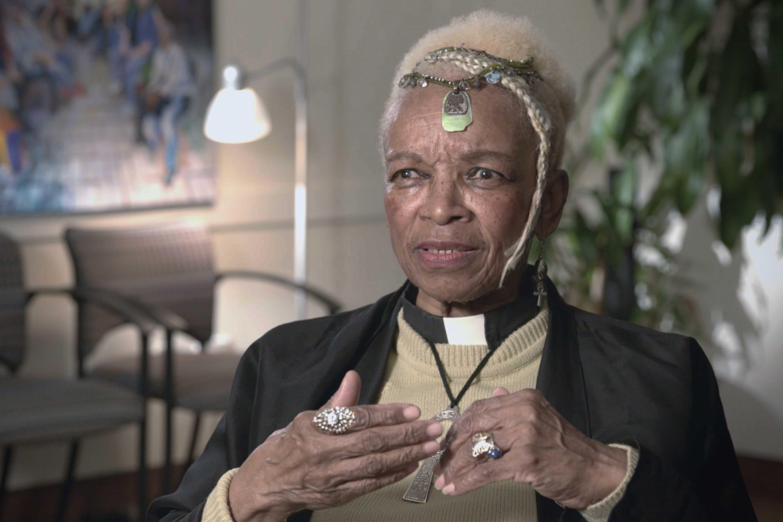 Rev. Kennedy sitting in her living room